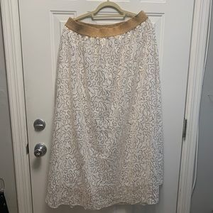 White skirt with gold sequins